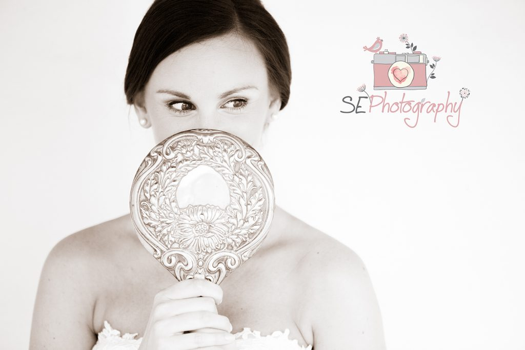 Bride with hand mirror